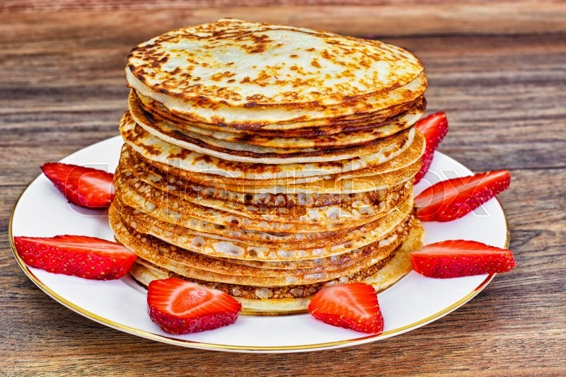 Stock image of 'Tasty Pancakes Stack with Strawberry Studio Photo'