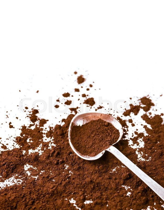 Stock image of 'Cocoa in a spoon isolated on a white background'