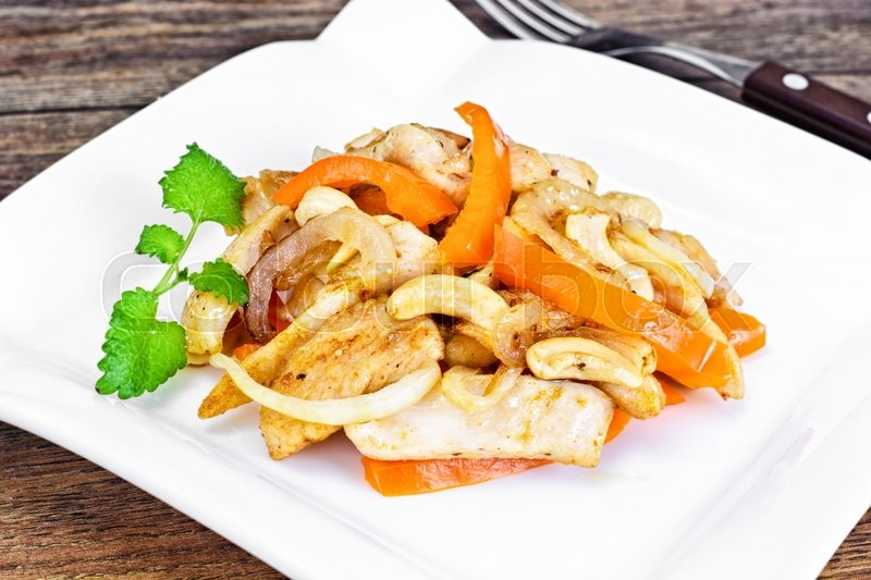 Stock image of 'Chicken with Cashew Nuts and Sweet Paprika Grilled. Asian, Thai Cuisine Studio Photo'