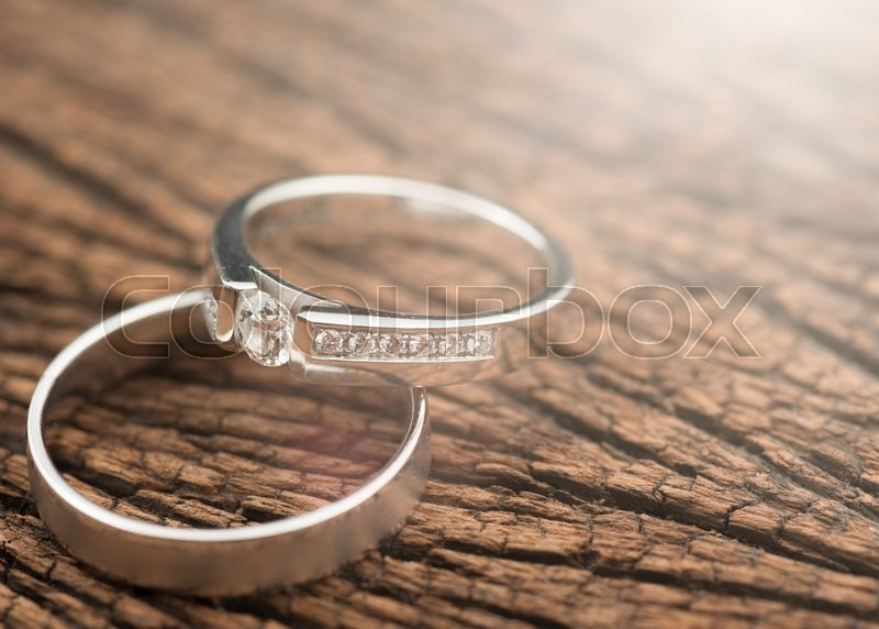 Stock image of 'Wedding rings on wood,Light Effect'