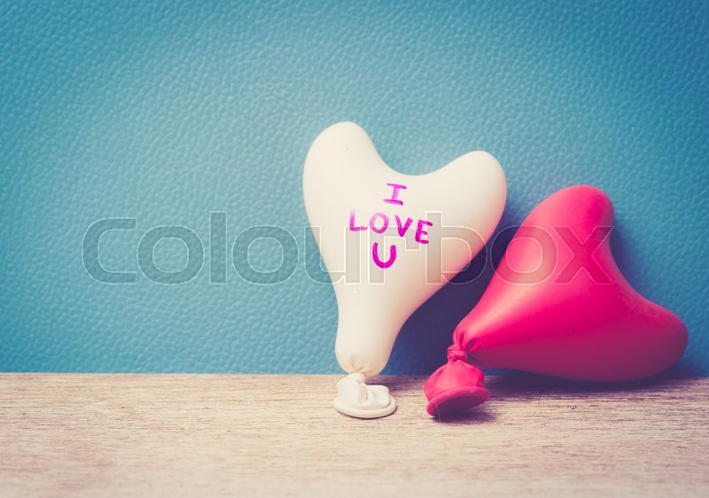 Stock image of 'Valentine day concept.heart balloon on white wood,vintage color toned image'