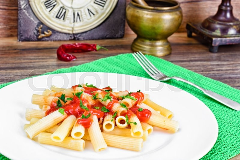 Stock image of 'Pasta with Tomato Ketchup Sauce, Green Onions and Cheese Studio Photo'