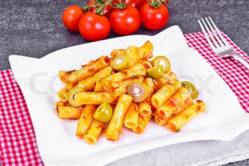 Stock image of 'Tortellini, Pasna Penne with Ketchup and Green Olives Studio Photo'
