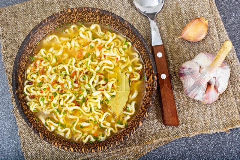 Stock image of 'Tasty Chicken Soup with Chinese Noodles. Studio Photo'
