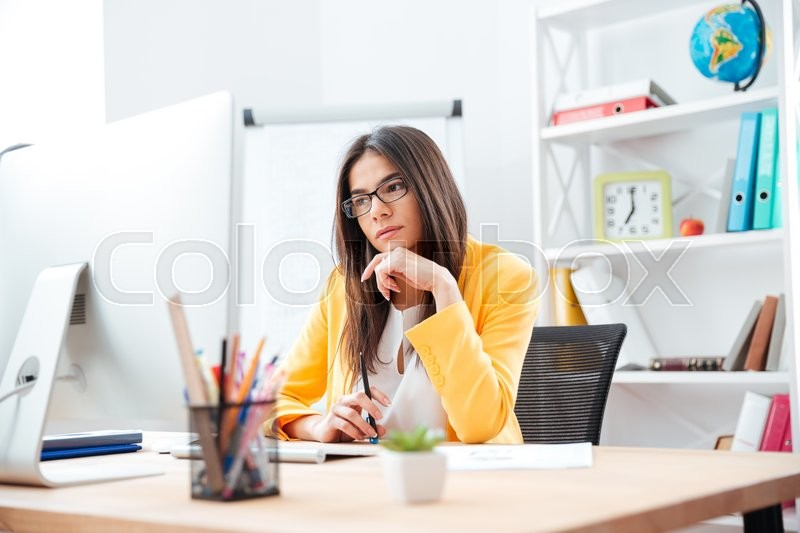 Stock image of 'Beautiful businesswoman working on computer in office'