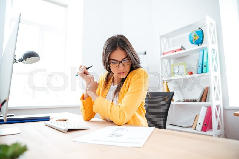Stock image of 'Businesswoman analysing document in office'