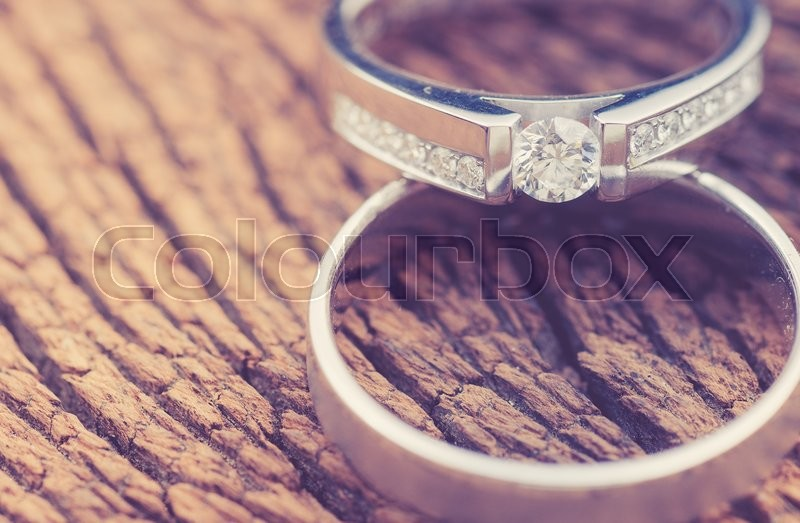 Stock image of 'Wedding rings on wood,vintage color toned image'
