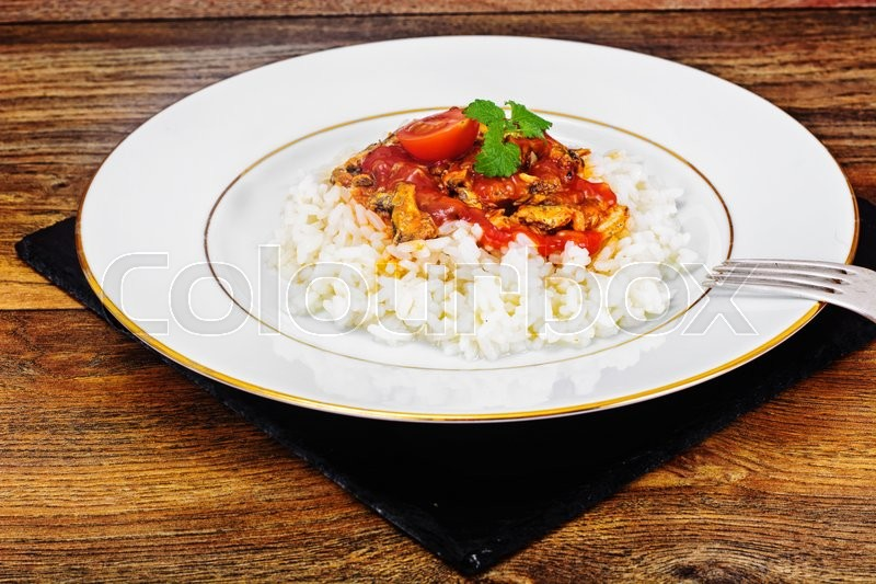 Stock image of 'Rice with Canned Fish in Tomato Sauce Studio Photo'