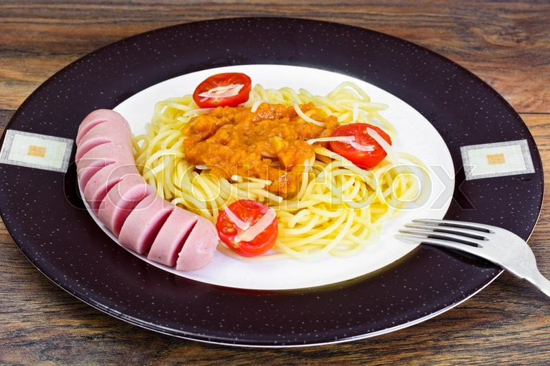 Stock image of 'Pasta with Sausage and Squash Caviar on Plate. Studio Photo'