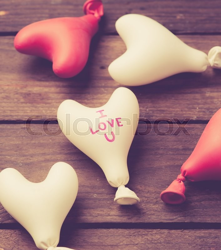 Stock image of 'Valentine day concept.heart balloon on wood,vintage color toned image'