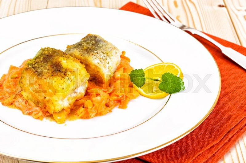 Stock image of 'Fish in Greek with Onion and Carrot Studio Photo'