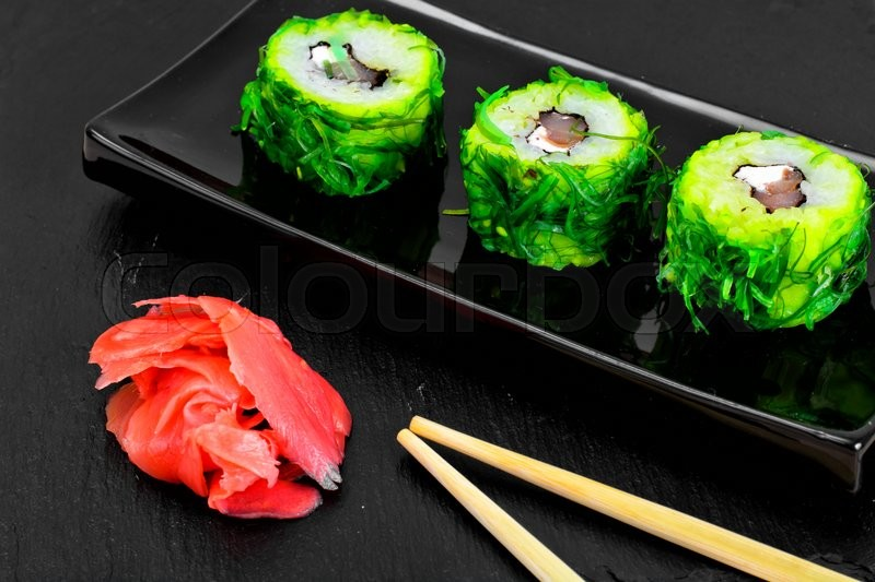Stock image of 'Sushi Roll with Chukoy, Salmon and Cheese. Studio Photo'