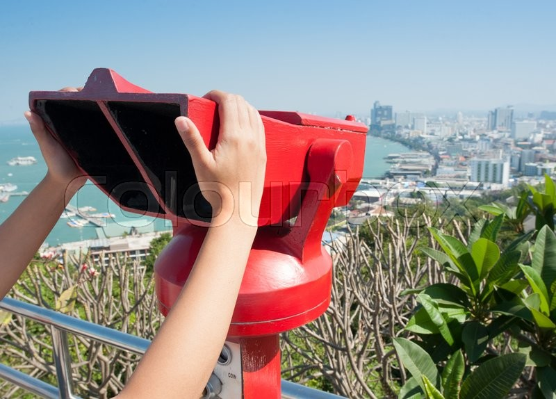 Stock image of 'Coin operated viewfinder, red tourist telescope at pattaya'