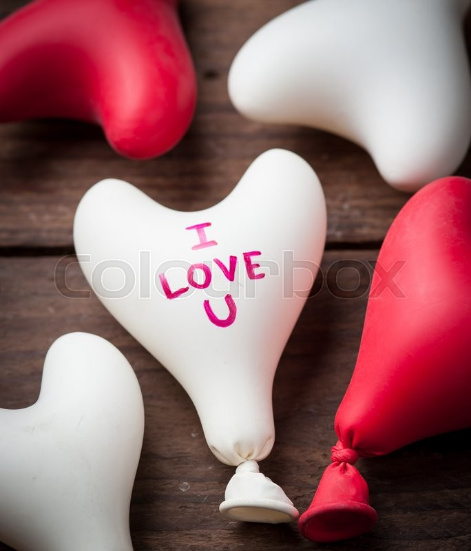 Stock image of 'Valentine day concept.heart balloon on wood'