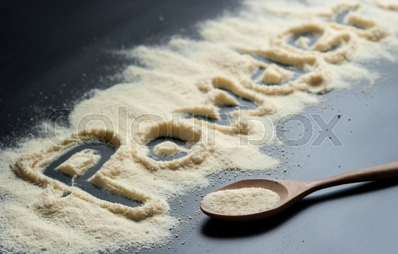 Stock image of 'Close up of a baby powder milk on a black slate'