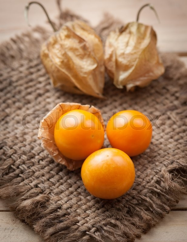 Stock image of 'Cape gooseberry on wooden background'