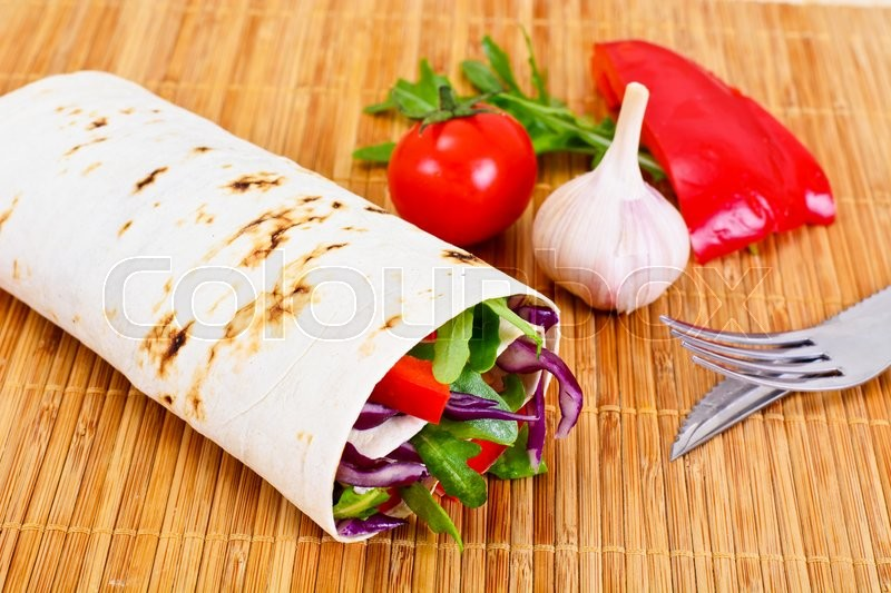 Stock image of 'Shawarma Lavash with Chicken and Vegetables Studio Photo'