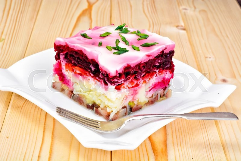 Stock image of 'Russian Shuba Salad with Beetroot, Potatoes, Carrots and Herring Studio Photo'