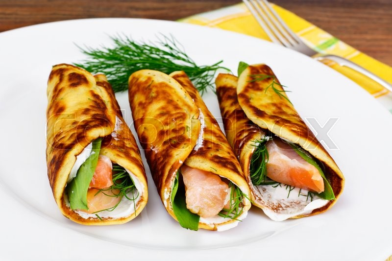 Stock image of 'Pancake Rolls with Salmon Fried, Goat Cheese, Fennel and Wild Garlic Leaves Studio Photo'