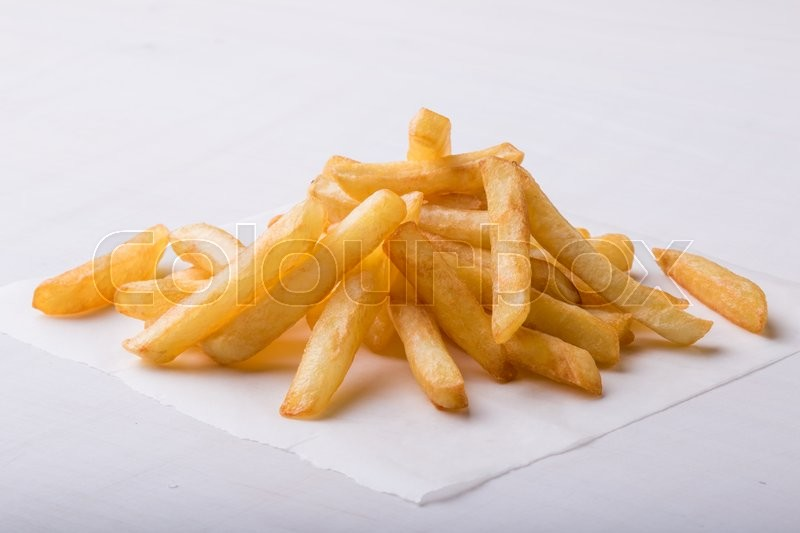 Stock image of 'fresh yellow fries on a white table'