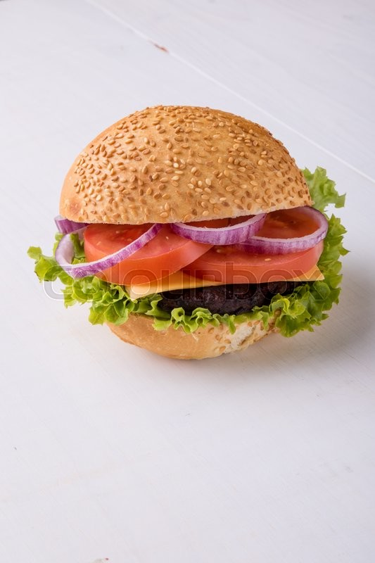 Stock image of 'tasty classic homemade hamburger on white table'