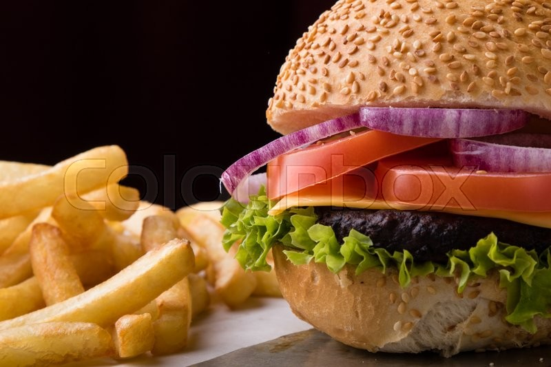 Stock image of 'tasty classic homemade hamburger on steel plate with fries'