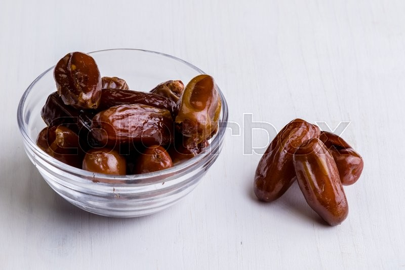 Stock image of 'sweet dried dates fruit on white table'