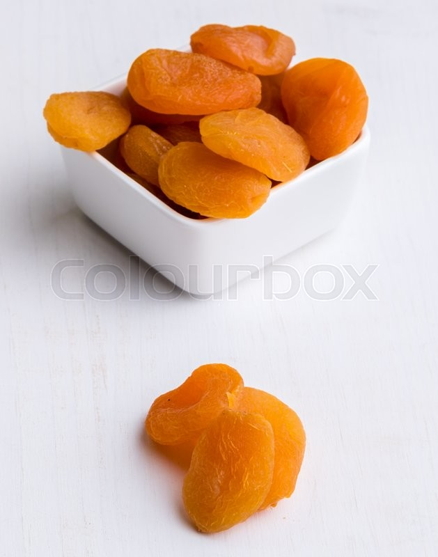 Stock image of 'sweet dried orange peach on white table'