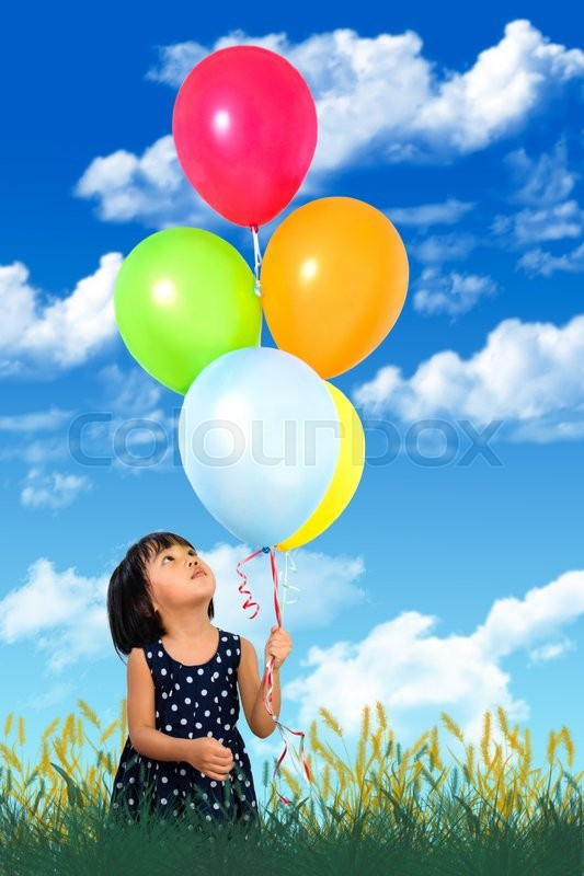 Stock image of 'Asian Little Chinese Girl Holding colorful balloons against Blue Sky'