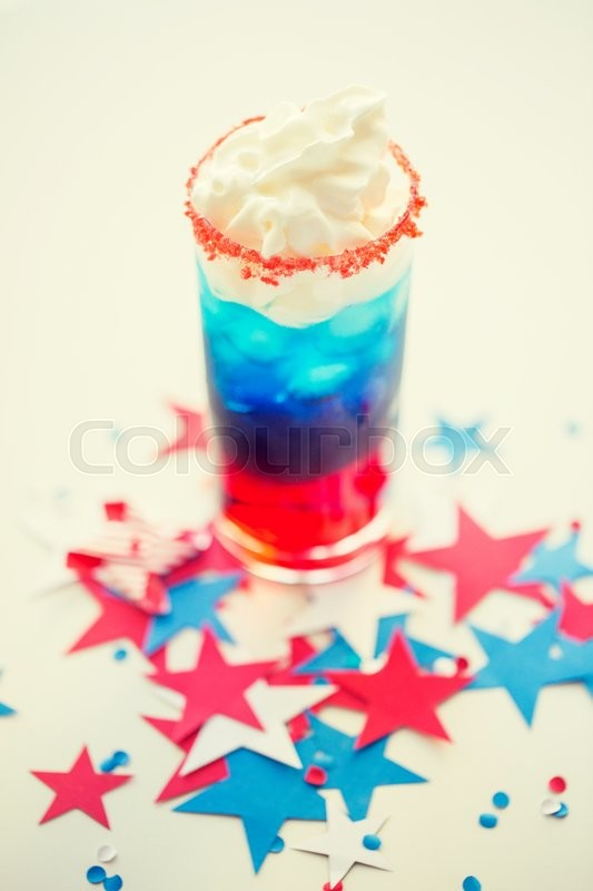 Stock image of 'american independence day, celebration, patriotism and holidays concept - glass of cocklatil drink with whipped cream and stars confetti decoration on american independence day party'