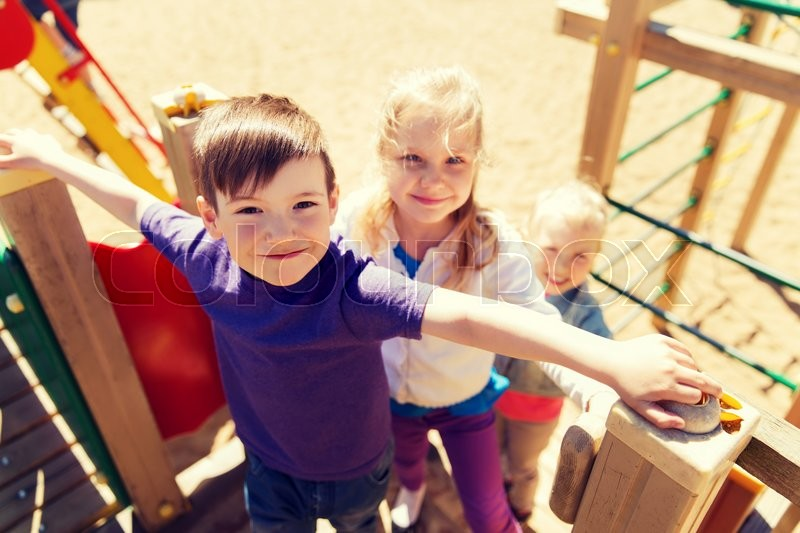 Stock image of 'summer, childhood, leisure, friendship and people concept - group of happy kids on children playground'