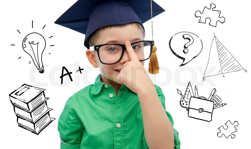 Stock image of 'childhood, school, education, knowledge and people concept - happy boy in bachelor hat or mortarboard and eyeglasses over doodles'