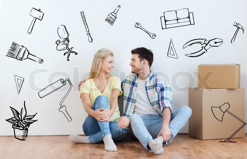 Stock image of 'home, people, repair, moving and real estate concept - happy couple with many cardboard boxes sitting on floor at new place over doodles'
