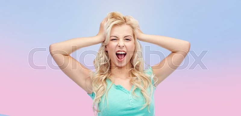 Stock image of 'emotions, expressions, hairstyle and people concept - smiling young woman or teenage girl holding to her head or touching hair over rose quartz and serenity gradient background'