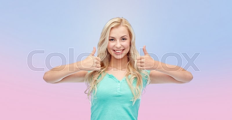 Stock image of 'positive gesture and people concept - smiling young woman or teenage girl showing thumbs up with both hands over rose quartz and serenity gradient background'