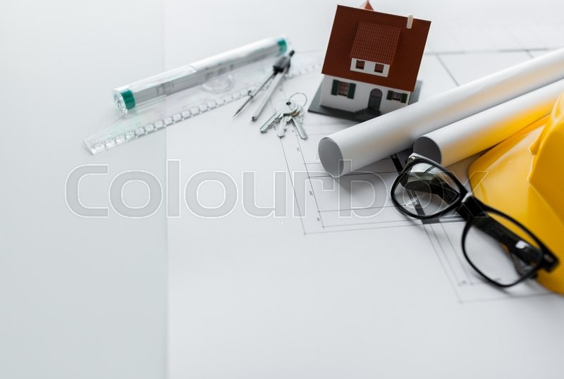 Stock image of 'architecture, building, construction, real estate and home concept - close up of architectural blueprint with tools and house keys'