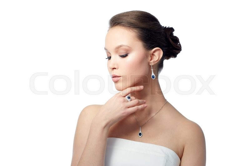 Stock image of 'beauty, jewelry, people and luxury concept - beautiful asian woman or bride with earring, finger ring and pendant'