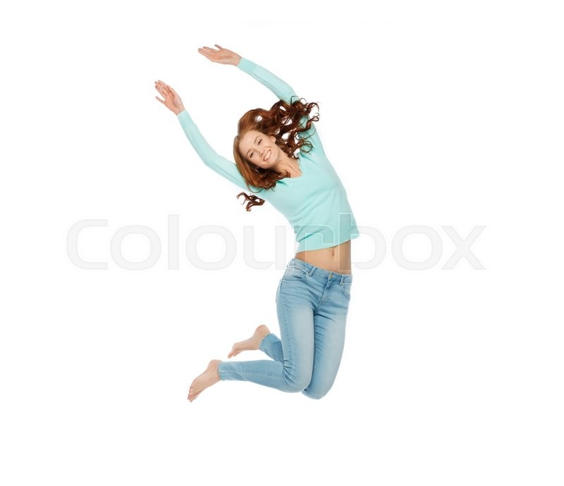 Stock image of 'happiness, freedom, motion and people concept - smiling young woman jumping in air'