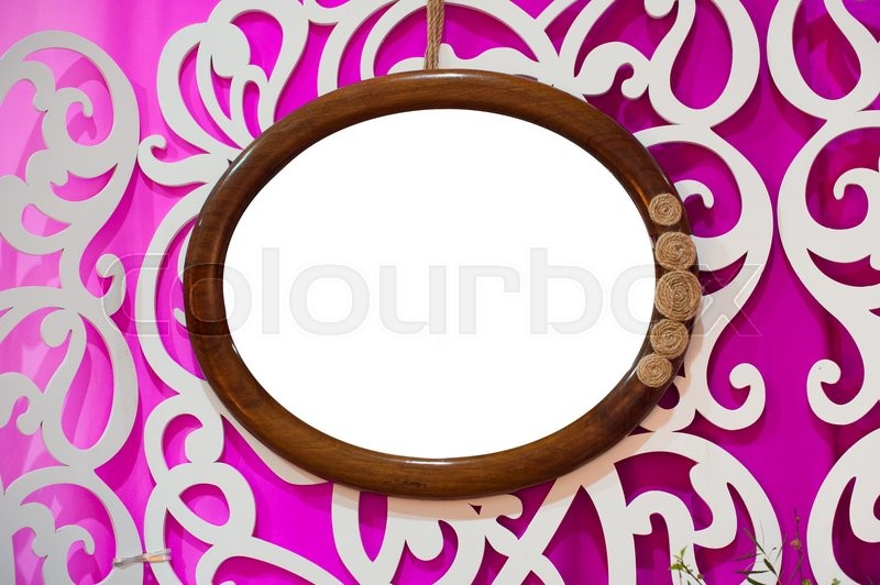Stock image of 'round of portrait frame isolated vintage hanging on the wall.'