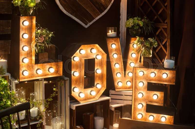 Stock image of 'letters love with lights in the interior of studio.'