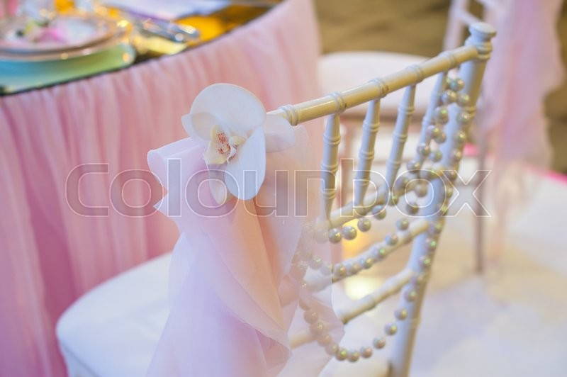 Stock image of 'decor for Wedding ceremony chairs and a wreath of flowers.'