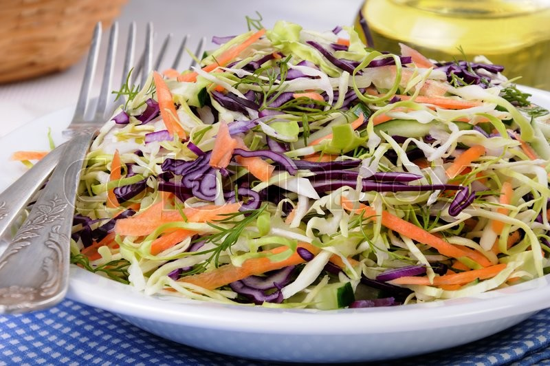 Stock image of 'Salad   coleslaw red and white cabbage with carrots and cucumber'