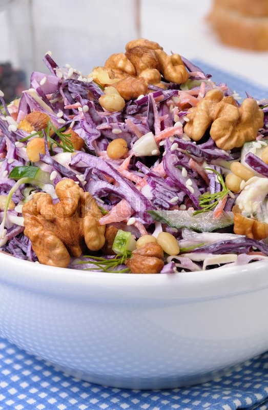 Stock image of 'salad of shredded red cabbage with nuts in milk sauce'