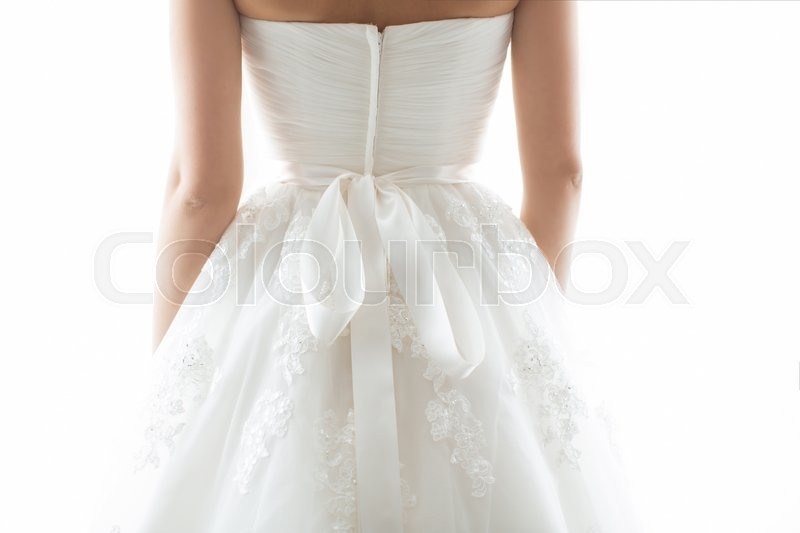 Stock image of 'Wedding dress back detail. Close-up of brides beauty against white background'
