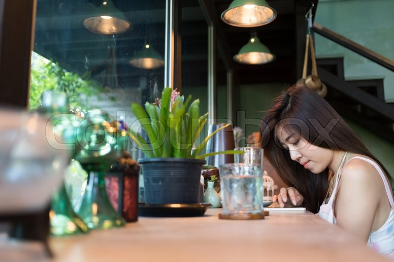 Stock image of 'lifestyle of women using a mobile phone in cafe coffee shop with texting message on app smartphone playing social network'