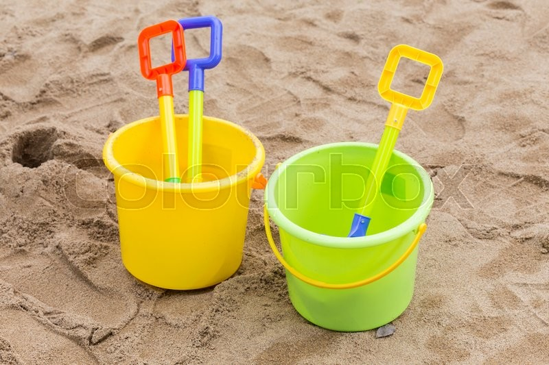 Stock image of 'Kid's toys for playing sand bucket and shovel in playground, enjoy with activity of family'