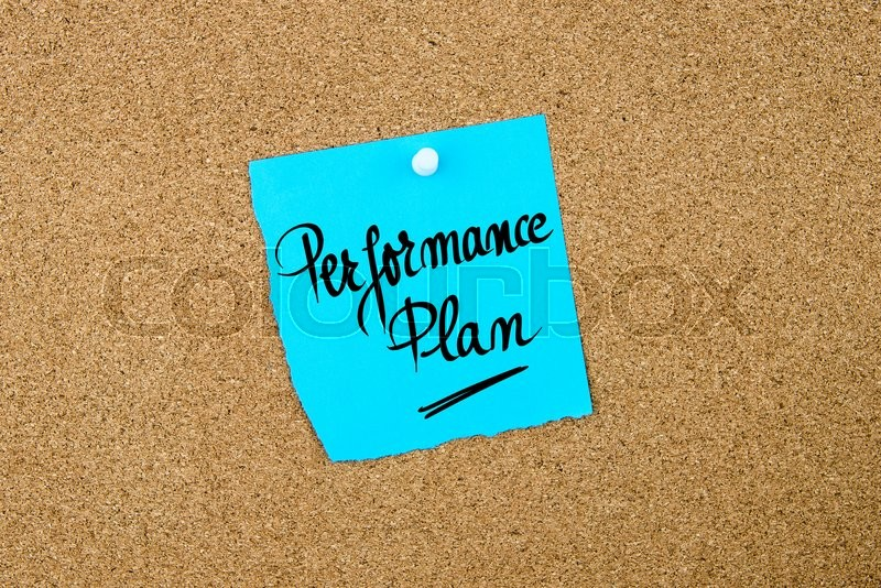 Stock image of 'Performance Plan written on blue paper note pinned on cork board with white thumbtacks, copy space available'