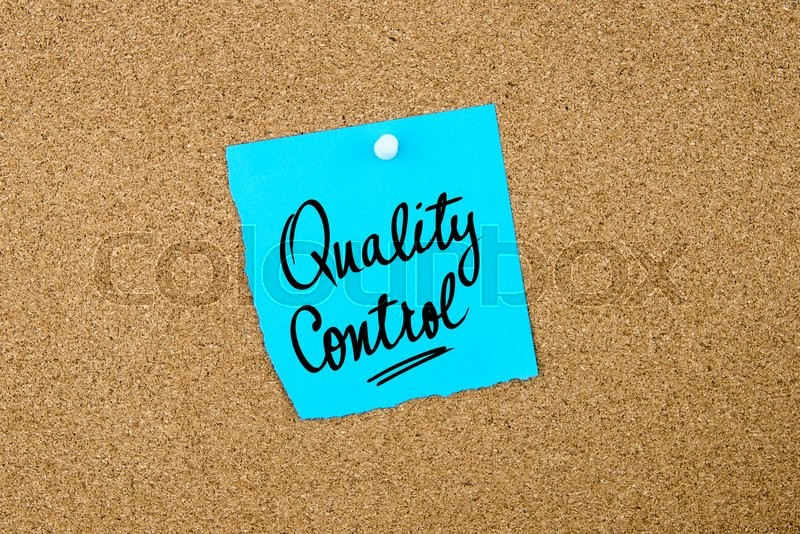 Stock image of 'Quality Control written on blue paper note pinned on cork board with white thumbtacks, copy space available'