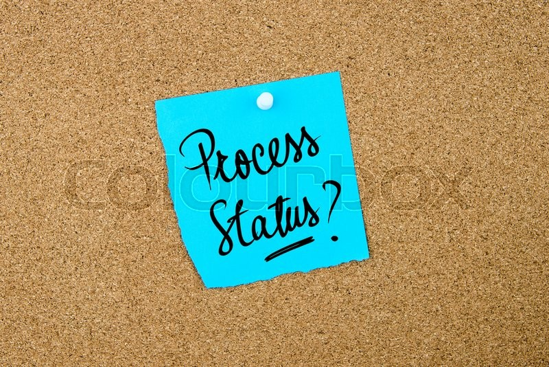 Stock image of 'Process Status ? written on blue paper note pinned on cork board with white thumbtacks, copy space available'