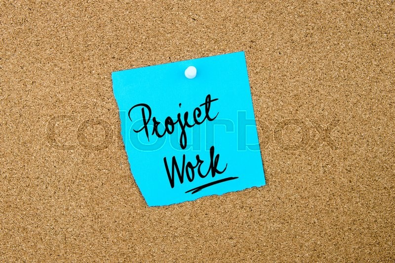 Stock image of 'Project Work written on blue paper note pinned on cork board with white thumbtacks, copy space available'